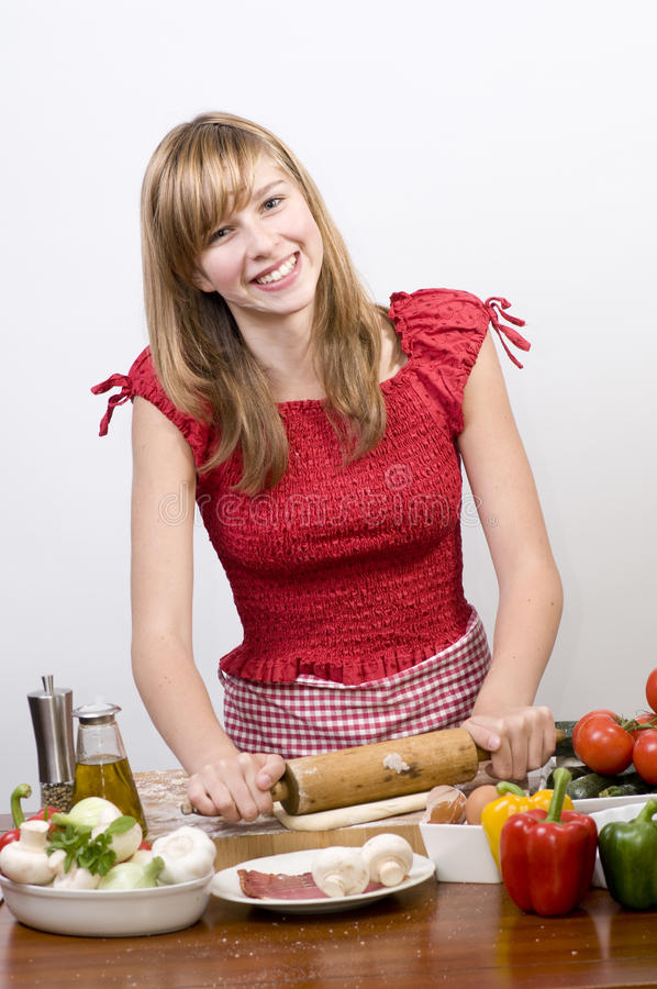 Download Young girl making pizza stock photo. Image of herbs, mozzarella - 9918556