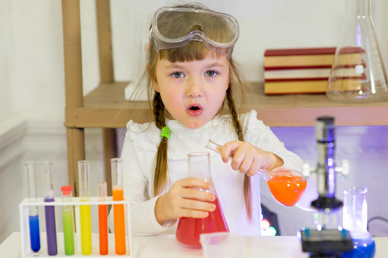 Young girl making science experiments. In laboratory. education royalty free stock photo