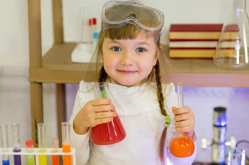 Young girl making science experiments. In laboratory. education stock photography