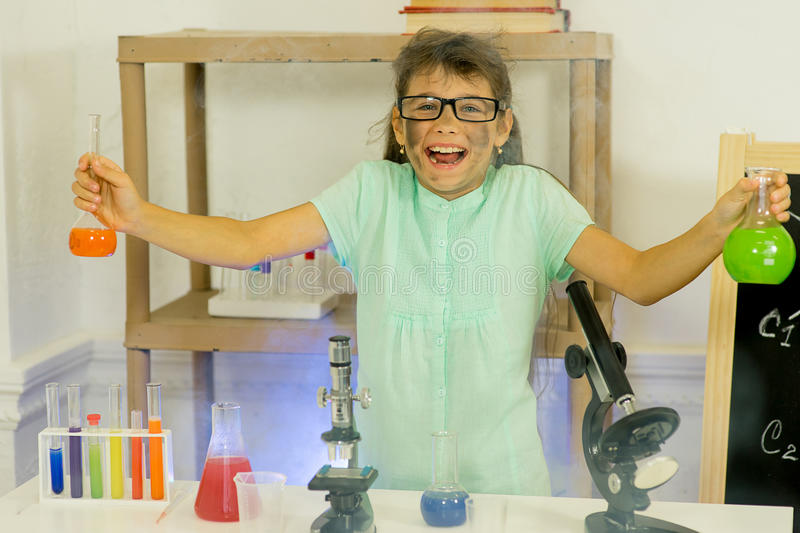 Young girl making science experiments. In laboratory. education royalty free stock images