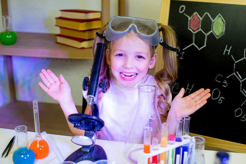 Young girl making science experiments. In laboratory. education stock photo