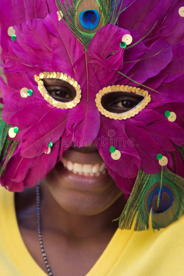 Young girl with mask. Young African girl with mask. Noise removed on portions (noise ninja), no sharpening applied. Different photos with the same model in my royalty free stock images