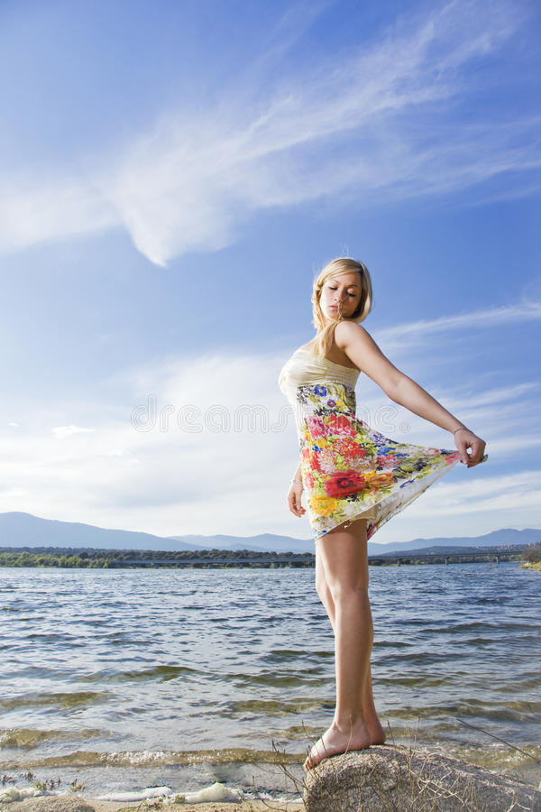Download Young girl in the nature stock photo. Image of water - 14842246