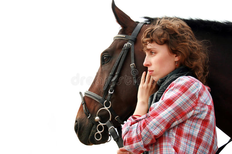 Young girl near horse. Looking ahead royalty free stock photo