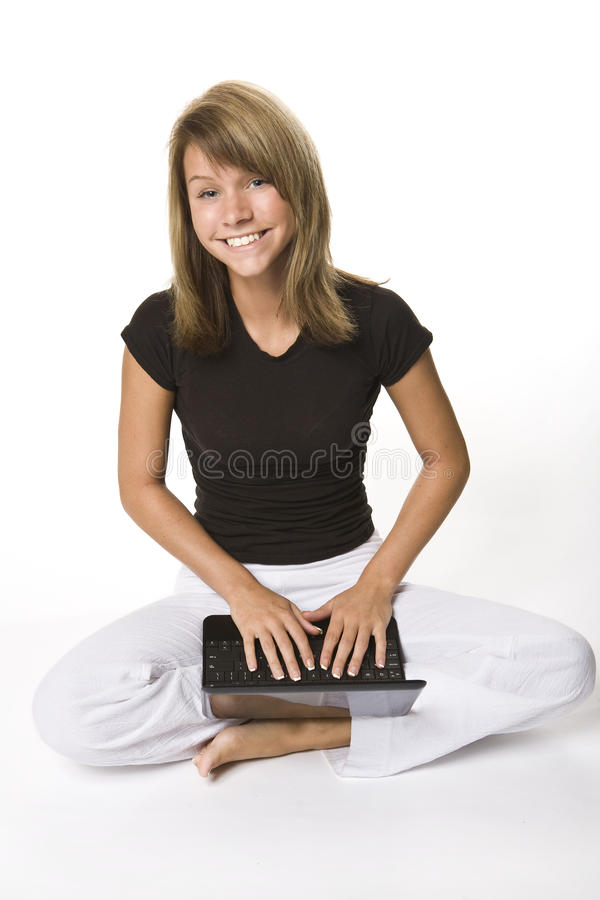 Young Girl With Netbook Royalty Free Stock Photos