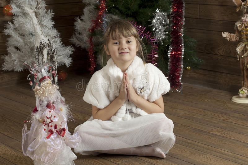 Young girl in New Year room stock images