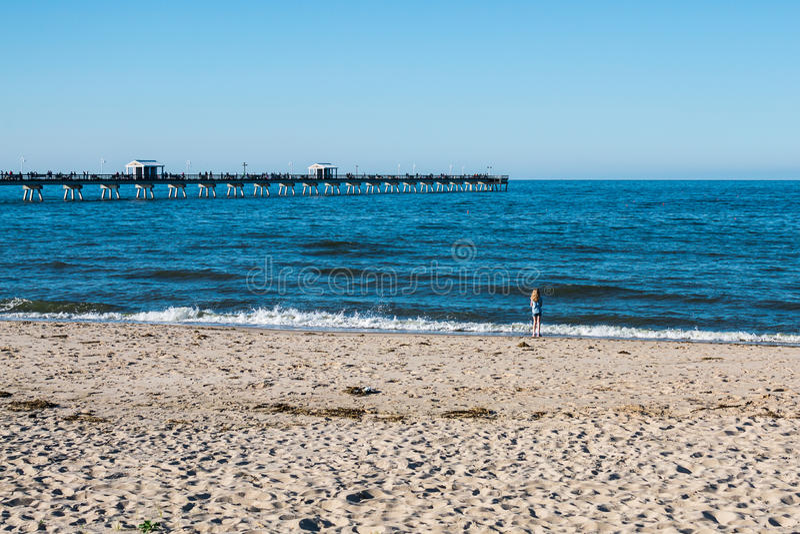 Young Girl on Ocean View Beach in Norfolk, Virginia stock image