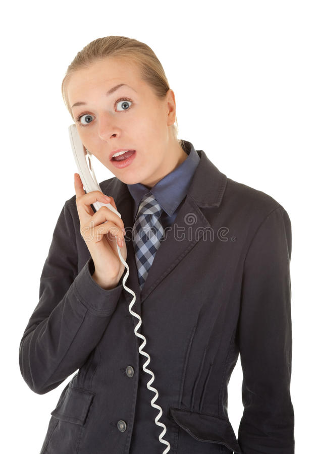 Young girl in office clothes talking on the phone stock photography