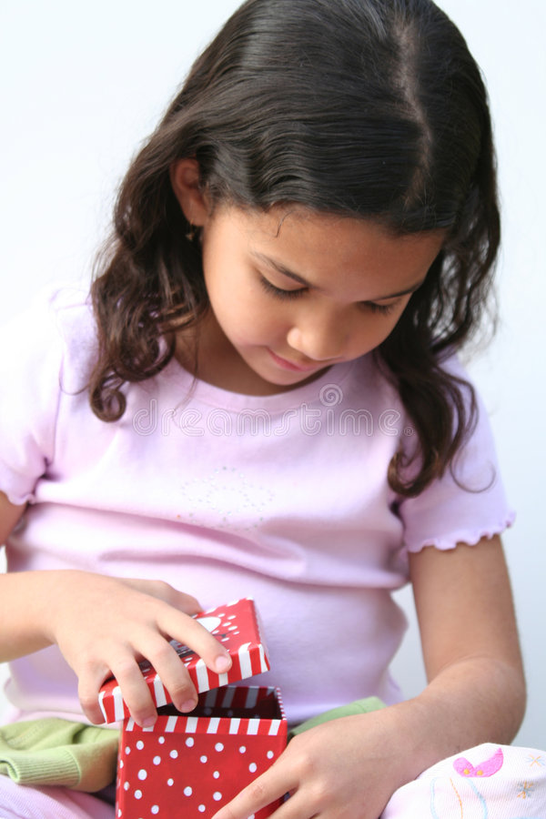 Download Young Girl Opening Present stock image. Image of face, female - 671049