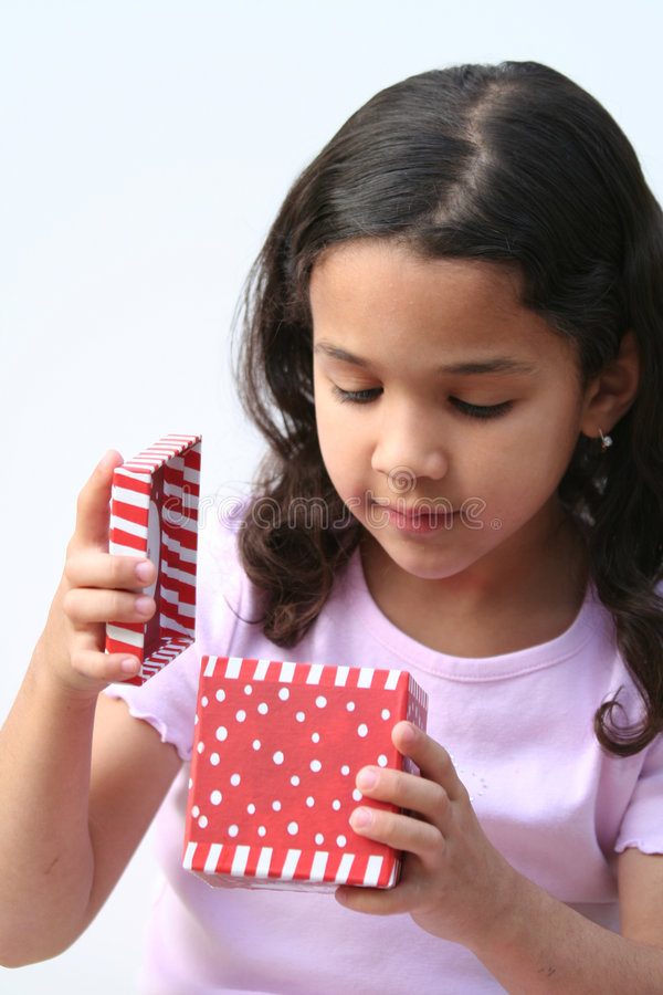 Download Young Girl Opening Present stock image. Image of background - 671055