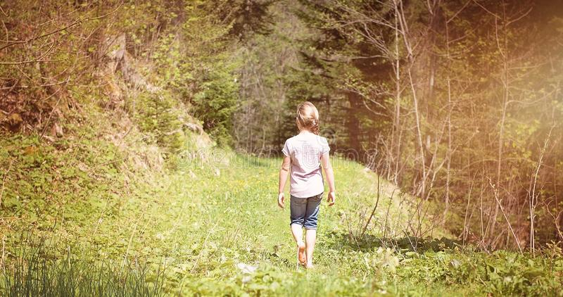 Young girl out walking in the countryside