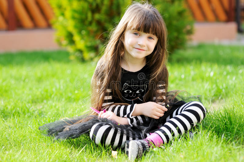 Young Girl Outdoors In Witch Costume On Halloween Stock Image