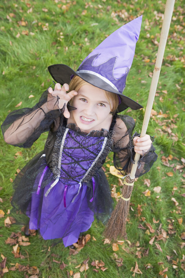 Download Young Girl Outdoors In Witch Costume On Halloween Stock Image - Image: 5942163