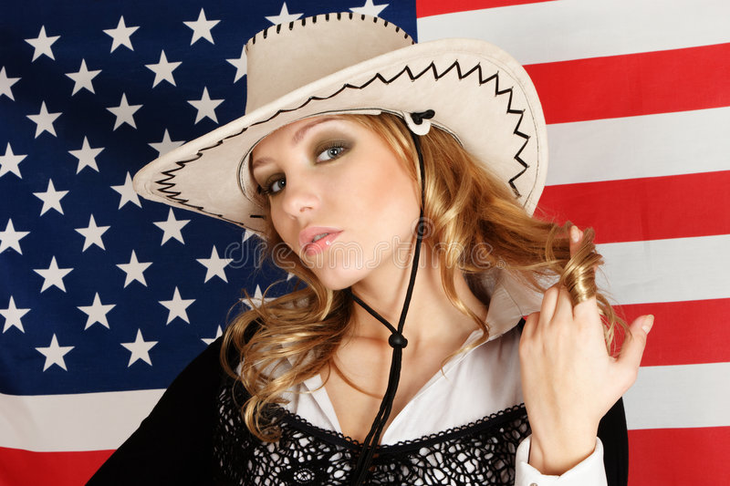 Young girl over american flag. Young blonde girl over american flag portrait royalty free stock image