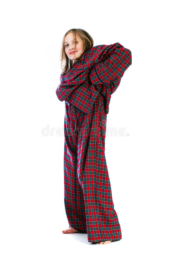Download Young Girl In Over Sized Pajamas Stock Photo - Image of pulling, young: 27677728