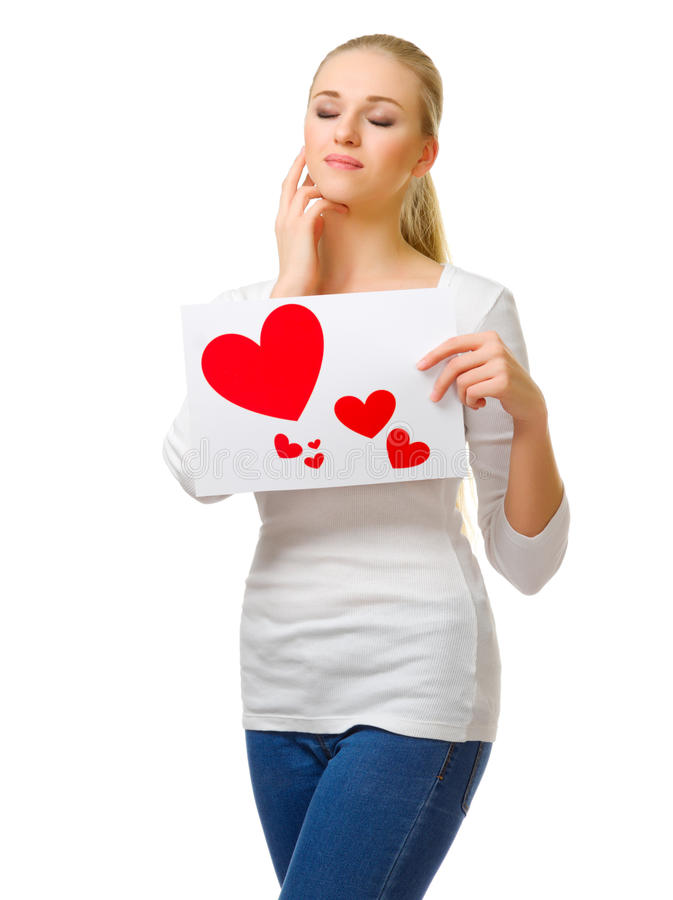 Young girl and paper sheet with hearts stock photo