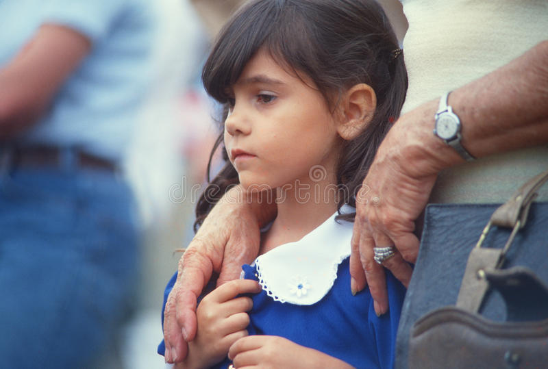 Young girl with parent