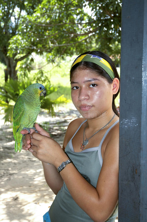 Download Young girl with parrot editorial photography. Image of wildlife - 25225102