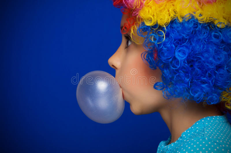 Young girl with party wig royalty free stock image