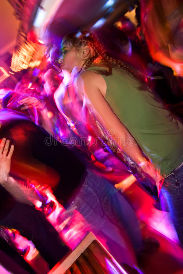 Young girl partying in the nightclub royalty free stock image