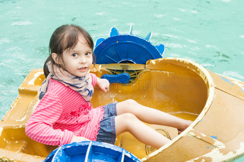 Young girl in a pedal boat stock photography
