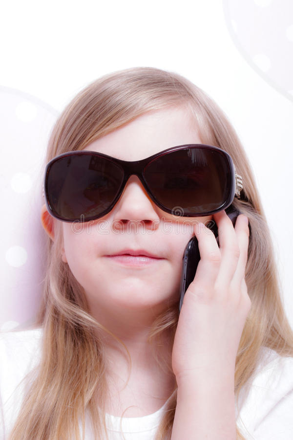 Young girl on the phone stock photography