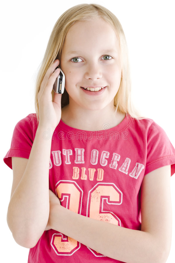 Young girl on the phone royalty free stock image