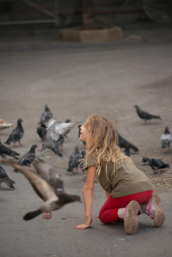 Young girl with pigeons royalty free stock photos