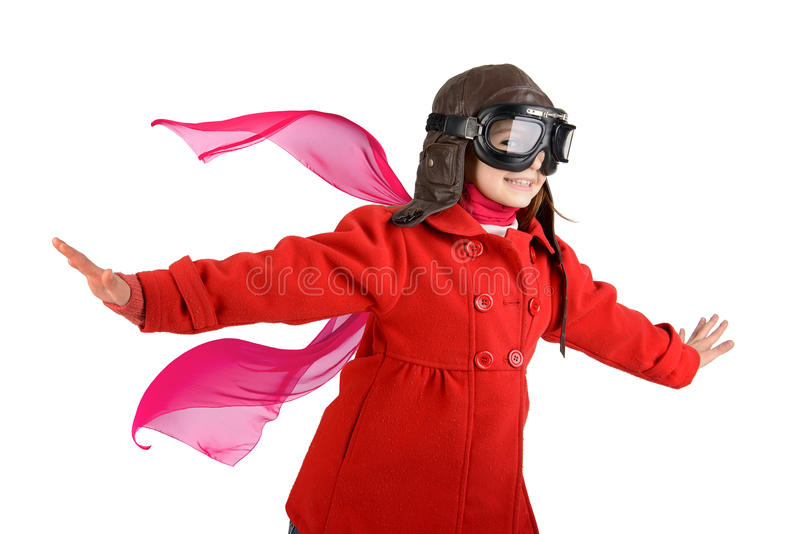 Girl pilot. Young girl with pilot goggles and hat isolated in white stock photo