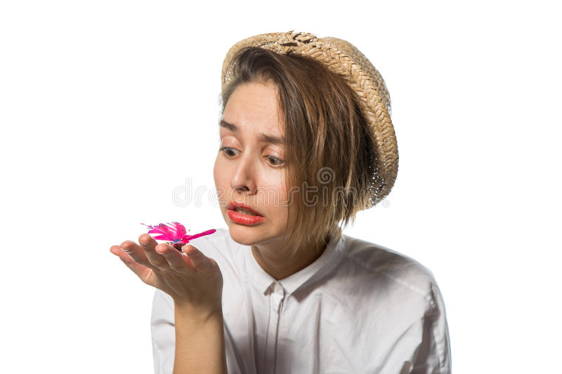 Young girl with a pink butterfly 1 royalty free stock photo