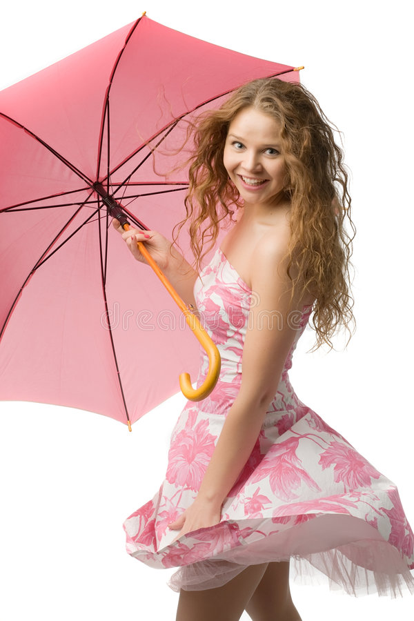 Young girl with pink umbrella. Young long-haired girl in beautiful summer dress with pink umbrella in hands isolated on white royalty free stock photos