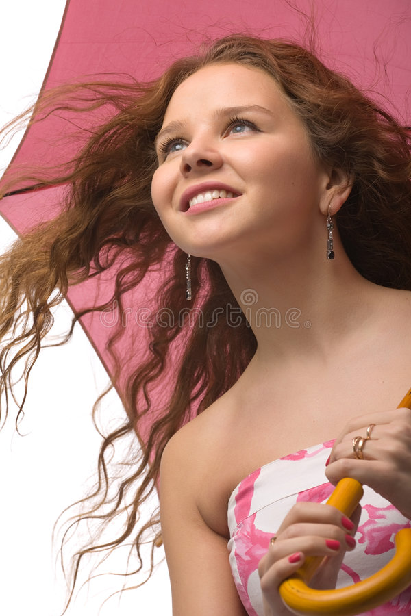 Young girl with pink umbrella. Young long-haired girl in beautiful summer dress with pink umbrella in hands isolated on white royalty free stock images