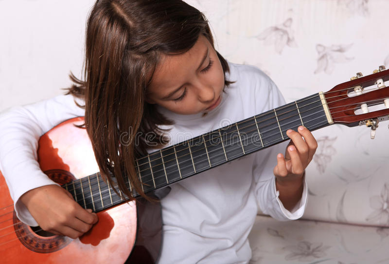 Download Young girl play guitar stock image. Image of cute, preschooler - 22057483
