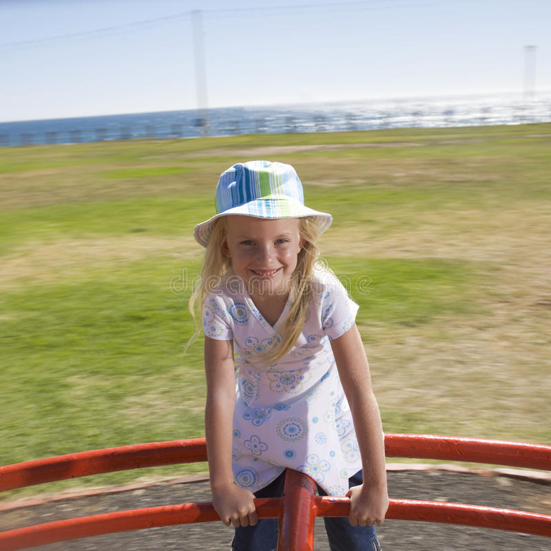 A young girl on a playground royalty free stock photo