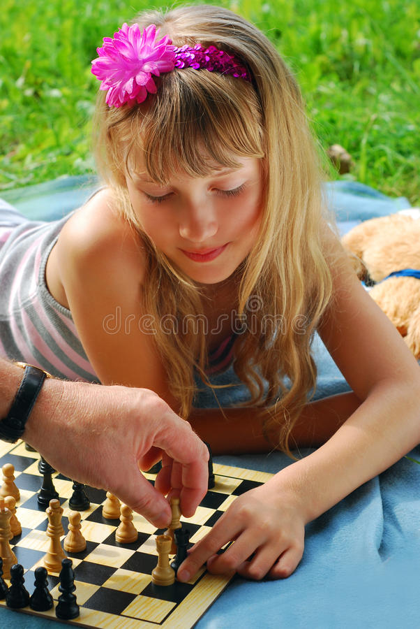 Young Girl Playing Chess Outside Stock Images