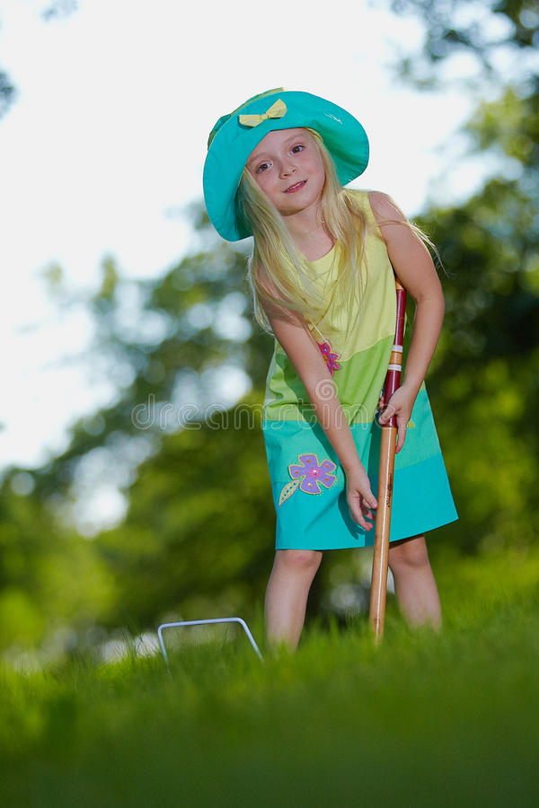 Young girl playing croquet royalty free stock photography