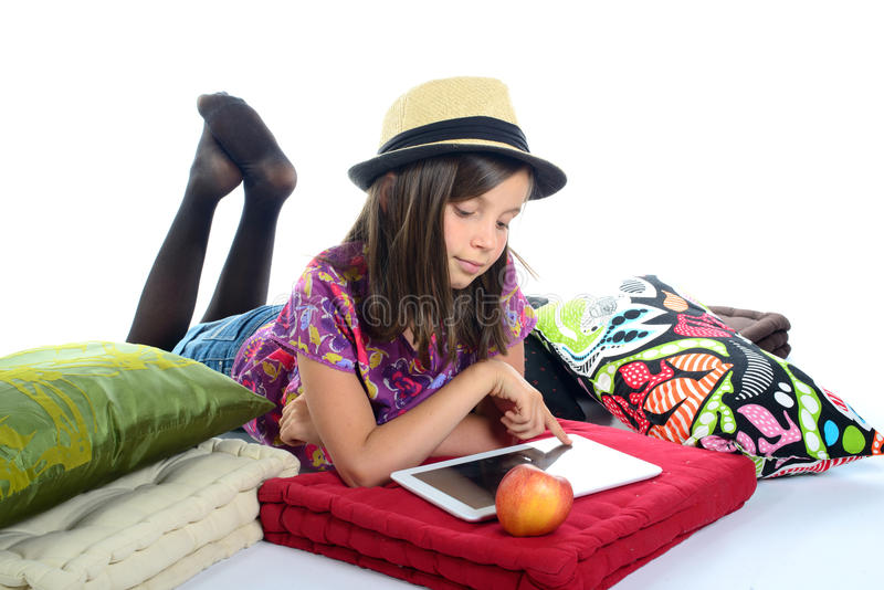 Young girl playing with a digital tablet stock photo