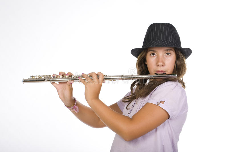 Young girl playing the flute stock photography