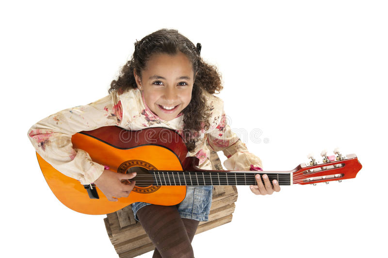 Young girl playing the guitar stock photo
