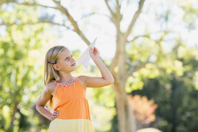 Young girl playing with a paper plane royalty free stock photos