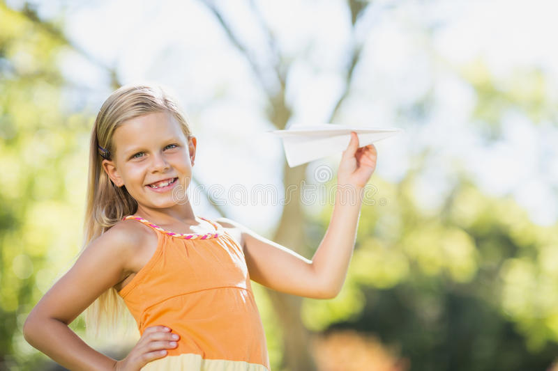 Young girl playing with a paper plane stock photos