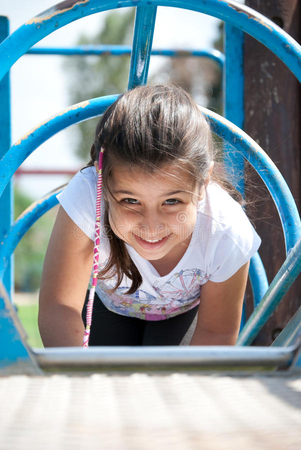 Young girl playing at the park royalty free stock images