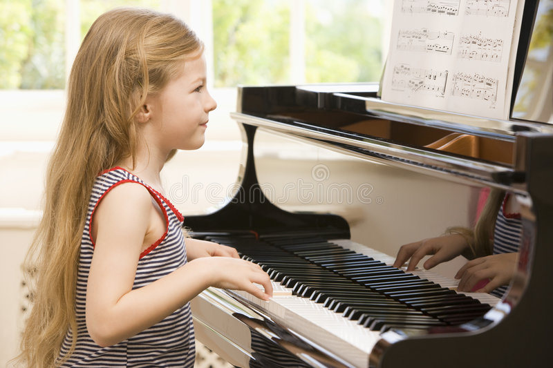 Download Young Girl Playing Piano stock photo. Image of kids, indoors - 6441490