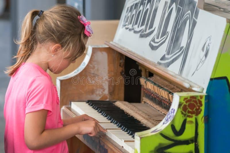 Nudist little girl playing piano — photo 11