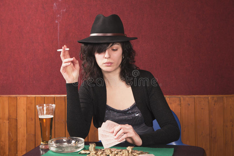 Download Young girl playing poker stock image. Image of addiction - 18208693