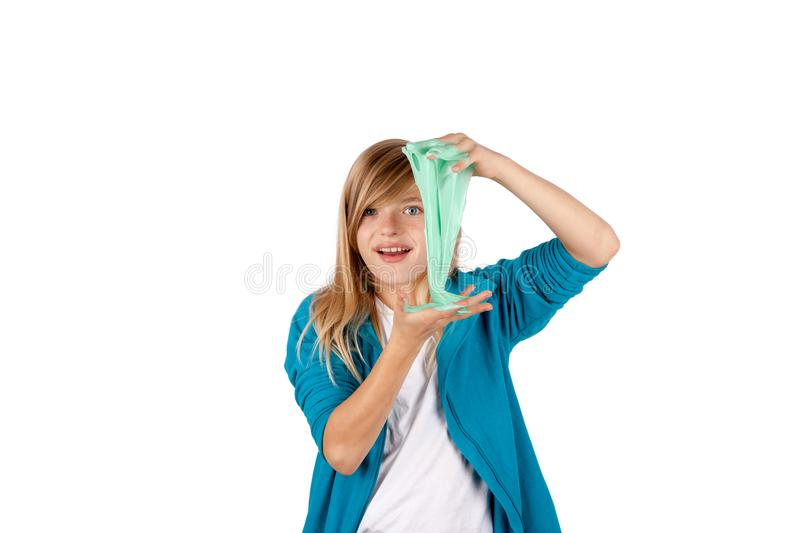 Young girl playing with slime. royalty free stock image
