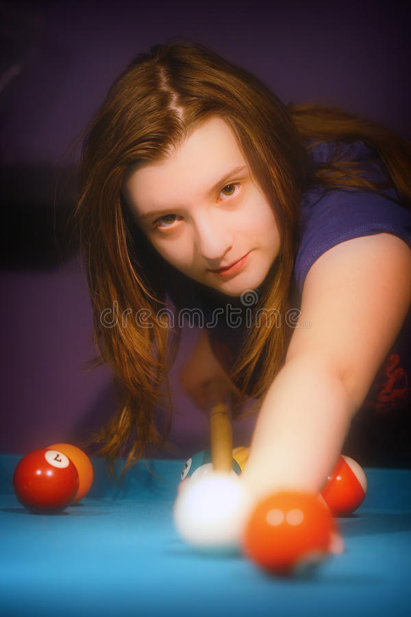 Young girl playing snooker stock photos