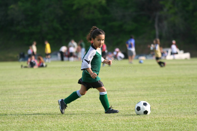 Download Young Girl Playing Soccer stock image. Image of green, girls - 753199