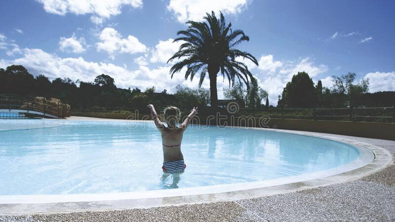 Young Girl Playing In Swimming Pool Free Public Domain Cc0 Image