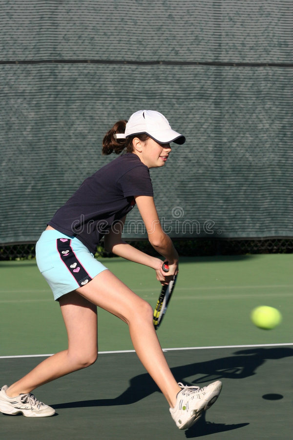 Download Young girl playing tennis stock image. Image of play, hitting - 461599